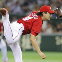 Youthful exuberance: Carp right-hander Daichi Osera fires a pitch against the Giants on Friday at Tokyo Dome. Hiroshima beat Yomiuri 7-2. | KYODO