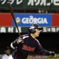 Every run counts: The Swallows' Shingo Kawabata belts a two-run home run in the first inning against the Lions on Friday at Seibu Dome. Tokyo Yakult defeated Seibu 8-4. | KYODO