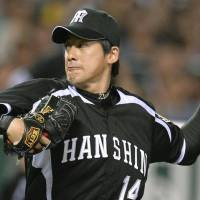 He's got it going: The Tigers' Atsushi Nomi pitches against the Hawks on Sunday at Yafuoku Dome in Fukuoka. Nomi struck out 13 in Hanshin's 4-3 win.   KYODO
