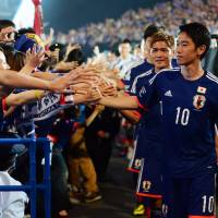 Top priority: Japan forward Shinji Kagawa says he will not be concerned if Japan loses its upcoming friendlies against Cyprus, Costa Rica and Zambia as long as the Blue Samurai do well at the World Cup in Brazil. | AFP-JIJI