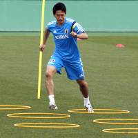 Eyes on the prize: Shinji Kagawa participates in a training session on Monday in Tokyo. | AP