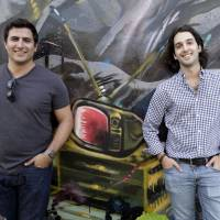 Wifredo Fernandez (left) and Daniel Lafuente, co-founders of a new tech-focused collaborative space called Lab Miami, pose at the lab. | AP