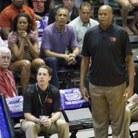 Not good enough: Oregon State men's basketball Craig Robinson (right) was fired on Monday after not leading the school to the NCAA tournament in six seasons. In this December 2013 file photo, he's seen watching his team play Akron along with his brother-in-law, President Barack Obama (top center), and his sister, first lady Michelle Obama (top left), during a game at the Diamond Head Classic in Honolulu. | AP