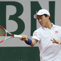 Not in the script: Kei Nishikori plays a shot during his first-round defeat to Slovakia's Martin Klizan at the French Open on Monday. | AFP-JIJI