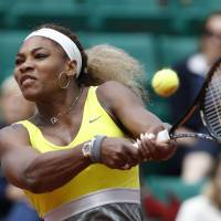 Another one bites the dust: World No. 1Serena Williams hits a return against Garbine Muguruza during the second round of the French Open on Wednesday in Paris. Muguruzu upset Williams 6-2, 6-2 to advance. | AP