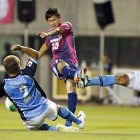 Must be ready: Cerezo Osaka's Takumi Minamino (center) could be called upon to compete for Japan's 2014 World Cup team. | KYODO