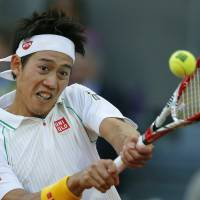 Sit this one out: Kei Nishikori plays a shot during his Madrid Open final match against Rafael Nadal on Sunday. Nishikori withdrew injured and has now pulled out of the Rome Masters. | AP