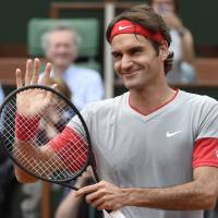 Nothing to see here: Roger Federer smiles after his 6-2, 6-4, 6-2 win over Lukas Lacko in the first round of the French Open on Sunday. | AFP-JIJI