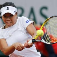Ousted in the second round: Kurumi Nara returns a shot to Jelena Jankovic during their second-round French Open match on Thursday. Jankovic won 7-5, 6-0. | REUTERS/KYODO