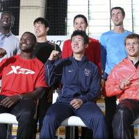 Golden smiles: (Front row, from left) Justin Gatlin, Yoshihide Kiryu and Christophe Lemaitre pose at a news conference on Saturday ahead of Sunday's Golden Grand Prix meet in Tokyo. | AP