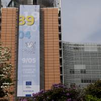 A banner reading '89-04, May 9 Europe Day' in memorial of the fall of the Berlin Wall in 1989 and 10 countries joining the European Union in 2004 is on display in front of the European Commission headquarters in Brussels, Belgium. | EUROPEAN UNION