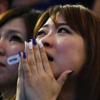 Japan's supporters at a public viewing event at Tokyo Dome react after Samurai Blue lost their 2014 World Cup Group C soccer match against Cote d'Ivoire. | REUTERS