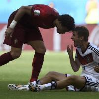 Portugal's Pepe (left) was red-carded in the 37th minute after pushing his head into  Germany's Thomas Mueller. | REUTERS