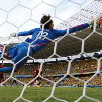 Mexico goalkeeper Guillermo Ochoa makes a save on a shot by Brazil's Neymar during Tuesday's match. | REUTERS