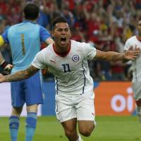 Chile's Eduardo Vargas celebrates after scoring the first goal for his side against Spain during their Group B match on Wednesday.  | REUTERS