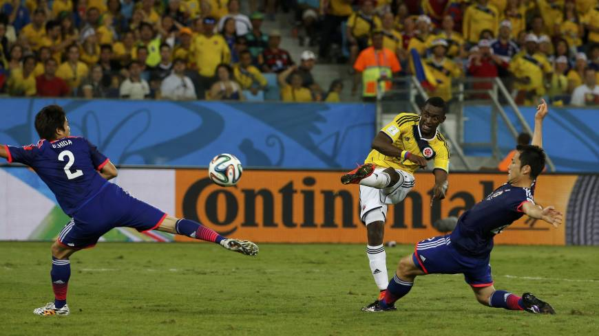 Colombia's Jackson Martinez scores his second goal against Japan during Tuesday's Group C match at the Pantanal arena in Cuiaba. | REUTERS