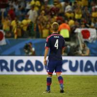 Japan's Keisuke Honda reacts at the end of Tuesday's Group C match against Colombia at the Pantanal arena in Cuiaba. | REUTERS