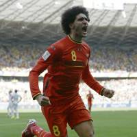 Belgium's Marouane Fellaini celebrates after heading home the equalizer during Tuesday's Group H match against Algeria at Mineirao Stadium in Belo Horizonte.   AP