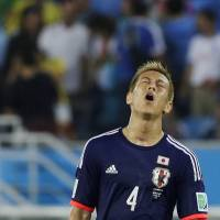 Japan midfielder Keisuke Honda walks off the pitch following their 0-0 draw with Greece on Thursday.  | AP