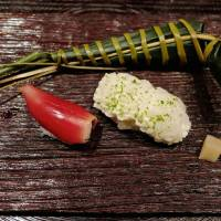 Morsels of sushi rice topped with anago (conger eel) and bright red, aromatic myōga bud. | ROBBIE SWINNERTON