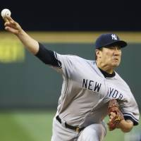 Dominant performance: Masahiro Tanaka of the New York Yankees unleashes a pitch against the Seattle Mariners during the fourth inning of Wednesday's game.  | AP