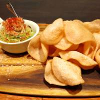 Crackers served with a crab and guacamole spread | ROBBIE SWINNERTON
