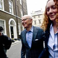 News Corp. Chairman Rupert Murdoch is seen in London in July 2011 with Rebekah Brooks, who ran his British newspapers group at the time. Brooks was acquitted Tuesday of overseeing illegal cellphone voicemail eavesdropping and the bribery of officials. | AP
