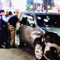 Police arrest Keiji Nagura in Ikebukuro, Tokyo, Tuesday evening after he rammed his car into pedestrians, killing one and injuring six. KYODO