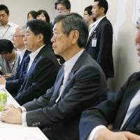 Liberal Democratic Party Vice President Masahiko Komura (second from right) attends talks Friday with other senior officials from the LDP and New Komeito. | KYODO