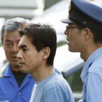 Kenjiro Hashizume leaves Machida Police Station on Friday morning. | KYODO