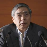 Bank of Japan Gov. Haruhiko Kuroda holds a news conference on May 21. | REUTERS