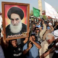 Reclusive cleric takes charge in Iraq crisis