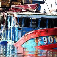 A Vietnamese fishing boat that reportedly sank after a confrontation with Chinese vessels is seen after being raised and taken to a shipyard in Danang on June 2. Officials in Hanoi say Chinese ships have damaged at least 24 Vietnamese vessels. | AFP-JIJI