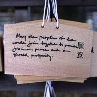 A wooden votive tablet with wishes written by visiting U.S. President Barack Obama hangs at Meiji Shrine in Tokyo on April 24. The tablet says: 'May the people of the world join together to promote justice, peace and our shared prosperity.'   AFP-JIJI