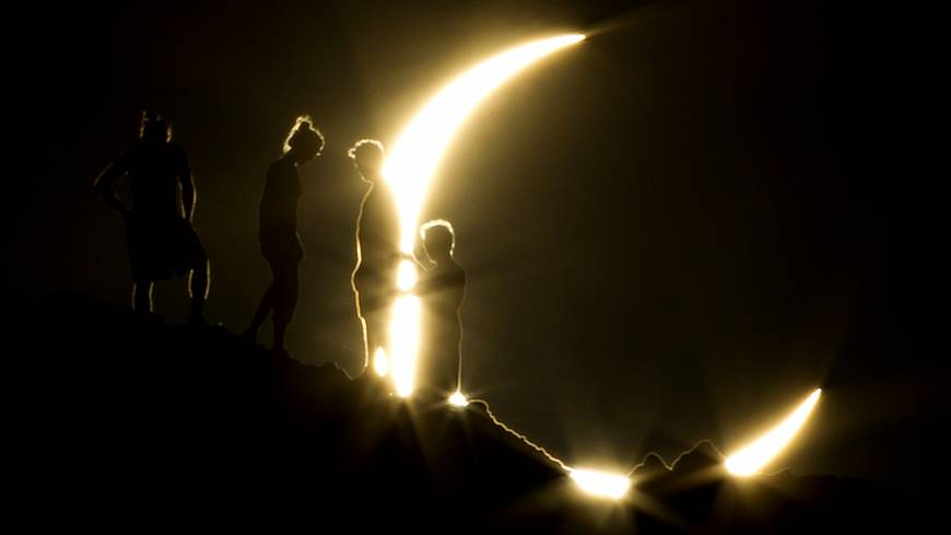 People watch an annular eclipse from Phoenix, Arizona, in May 2012. The event, also known as a 'Ring of Fire Eclipse,' was visible in wide areas across Japan, China and elsewhere in the Asia-Pacific region before moving across the ocean to become visible in parts of the western United States. | AP