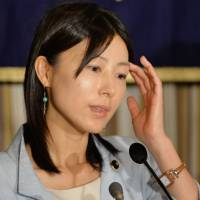Ayaka Shiomura, a member of the Tokyo Metropolitan Assembly who became the target of sexist jeers during an assembly session last week, answers questions during a news conference at the Foreign Correspondents' Club of Japan in Tokyo on Tuesday. | AFP-JIJI