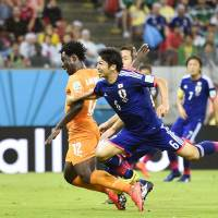 Wilfried Bony of Cote d'Ivoire scores during a slippery World Cup opening match against Japan in Recife, Brazil, on Saturday. | KYODO