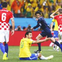 Referee Yuichi Nishimura awards a penalty during the World Cup opener Thursday between Brazil and Croatia in Sao Paulo.   | REUTERS