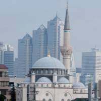 Spiritual center: The Tokyo Camii mosque in Yoyogi-Uehara, Shibuya Ward, was established in 1938 and rebuilt in 2000, using marble imported from Turkey. During the month of Ramadan, food is served here for the breaking of the fast.   COURTESY OF TOKYO CAMII