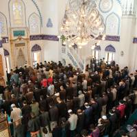 A piece of home: The multinational congregation at the Tokyo Camii attends Friday prayer.   COURTESY OF TOKYO CAMII