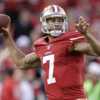 Cashing in: San Francisco 49ers QB Colin Kaepernick, who took the team to the Super Bowl two seasons ago, is now one of the highest paid players in the NFL. | AP