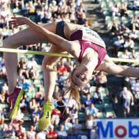 Up an over: Croatia's Ana Simic clears the bar in the high jump at the Bislett Games in Oslo on Wednesday. Simic finished third with a mark of 1.95 meters. | REUTERS
