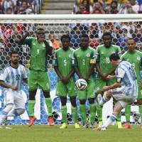 Maneuver it like Messi: Argentina's Lionel Messi scores against Nigeria on a free kick Wednesday in Porto Alegre, Brazil. | REUTERS