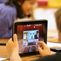 Hooked on apps: A child uses an iPad as part of a classroom activity. Parents who worry their children spend too much time looking at screens are looking to apps to limit their kids' use of mobile devices.   BLOOMBERG