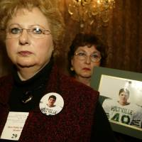 The 2004 hearing: Terri Williams (left) and Rhonda Thrower, wait in line to speak during a Food and Drug Administration public hearing on antidepressant drugs on Feb. 2, 2004, in Bethesda, Maryland. Williams' son Jacob committed suicide at age 14 while on antidepressant drugs. | AP