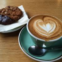 A flat white and cookie at Mojo Coffee. | REBECCA MILNER