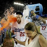 Shower time: Los Angeles' Clayton Kershaw gets drenched by teammates following his no-hitter against Colorado on Wednesday night. The Dodgers beat the Rockies 8-0.   AP
