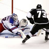 All over it: New York's Henrik Lundqvist makes a save on Los Angeles' Tyler Toffoli in Game 1 on Wednesday night. | REUTERS