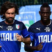 On to the next one: Italy's Andrea Pirlo (left) and Mario Balotelli prepare for Friday's match against Costa Rica during a training session on Monday.   AFP-JIJI