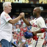 Historic moment: The Phillies' Jimmy Rollins (right) celebrates with Phillies legend Mike Schmidt after his fifth-inning single put him atop the team's all-time hits list on Saturday in Philadelphia.   AP